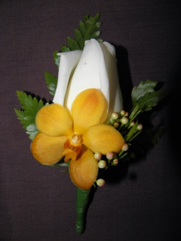 Buttonhole White rose and orange vanda orchid