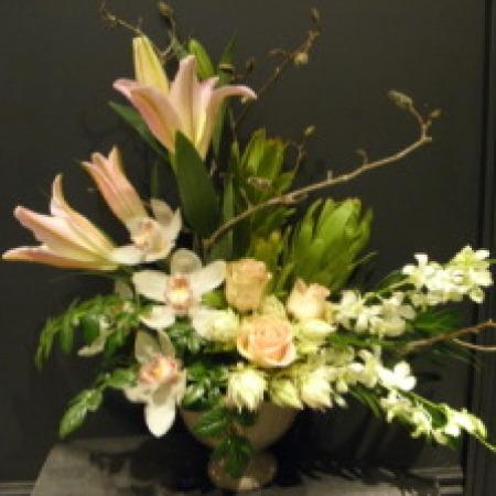 Flower Arrangement including orchids, roses & lilies